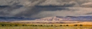 Storm Over Mesa Montosa (Ghost Ranch Cliffs), pastel on prepared paper, 10 x 28.75 inches [$900]